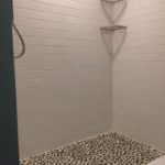 Tile Shower with river stone floor