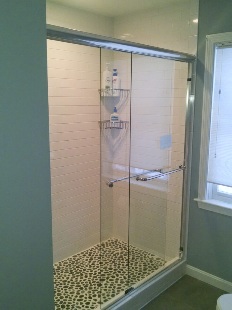 Basco Infinity Frameless Bipass Door with clear glass and Chrome Hardware. AquaGlide Protective Glass Coating