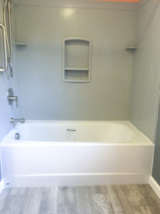 Swanstone tub surround and an Americast tub